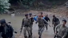CRPF personnel carry woman suffering from high fever on a stretcher for 7 km to a hospital in Chhattisgarh